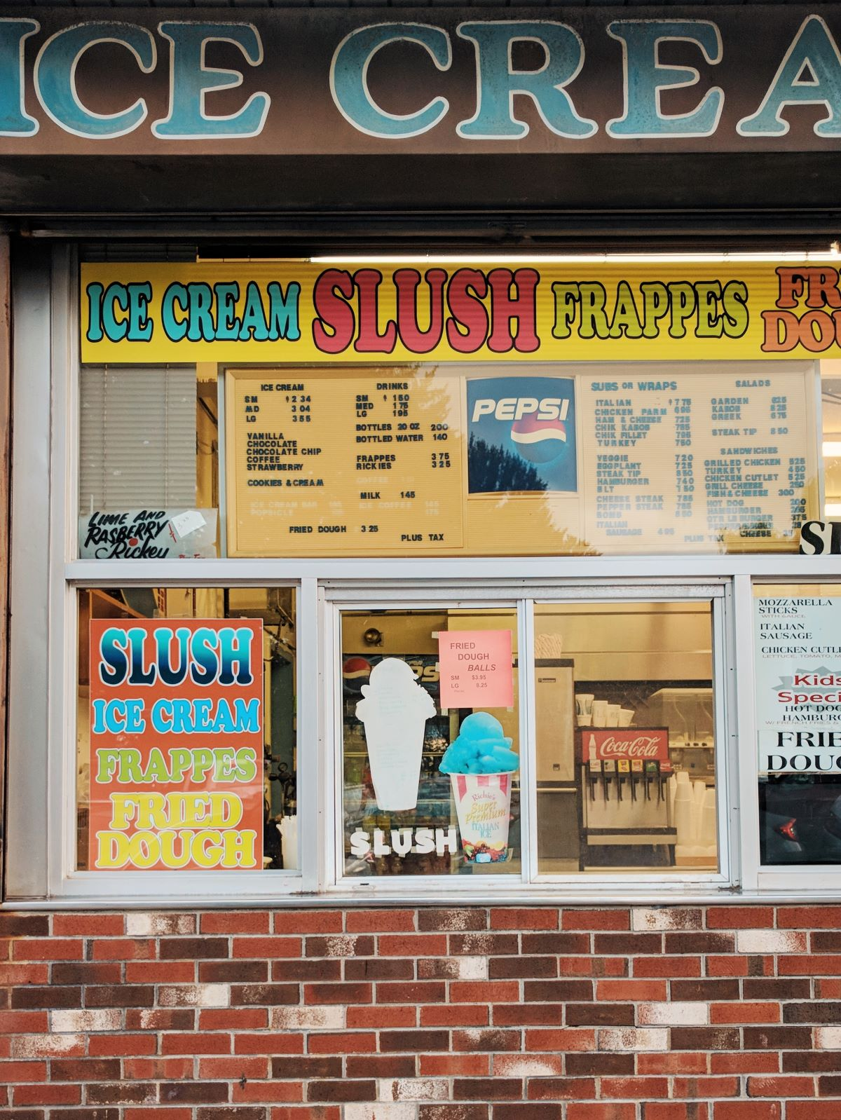 Fast food order window with ice cream, slushies, pizza, and more