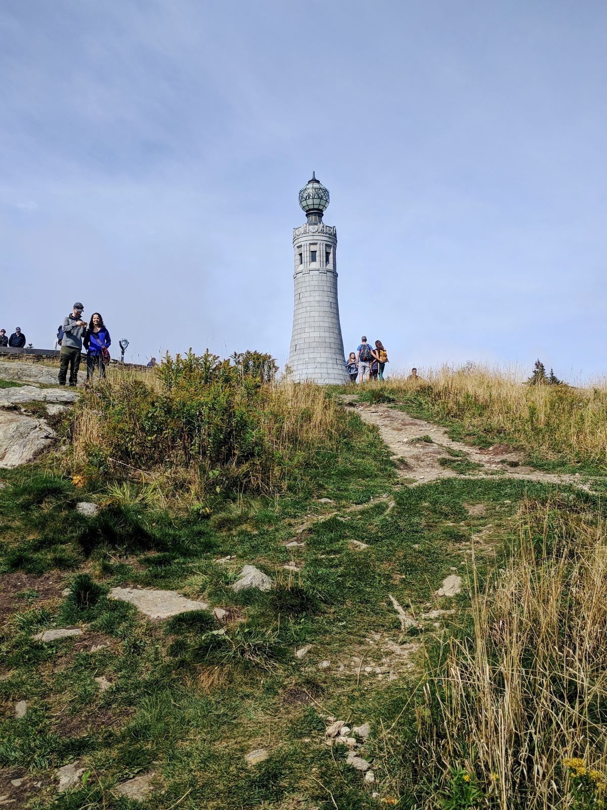 The white lighthouse-shaped Veteran's Memorial on the top of Mt Greylock