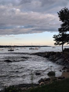 """Sunset at Salem Willows Park on a cloudy day, with boats in the marina"""""""