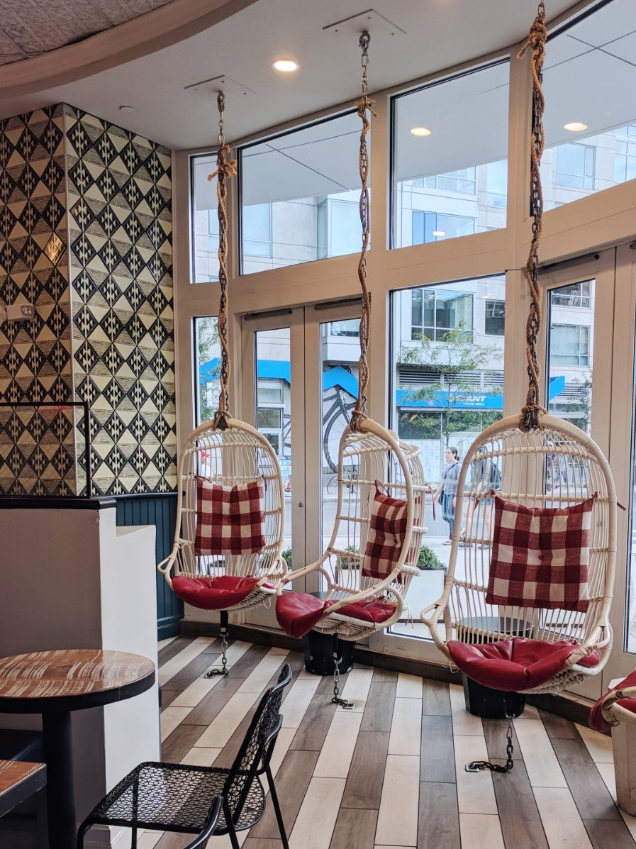 hanging wicker chairs with a red and white pattern