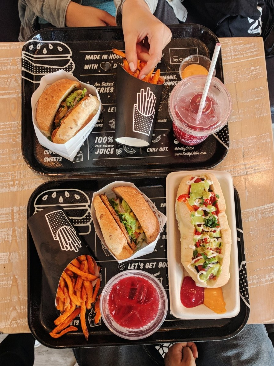 vegan burger and hot dog with fries and lemonade