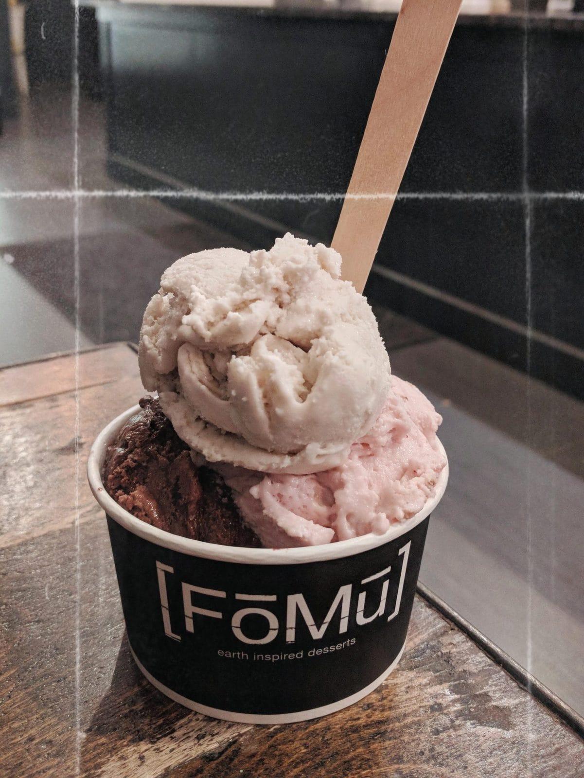 vanilla and strawberry ice cream in a cup