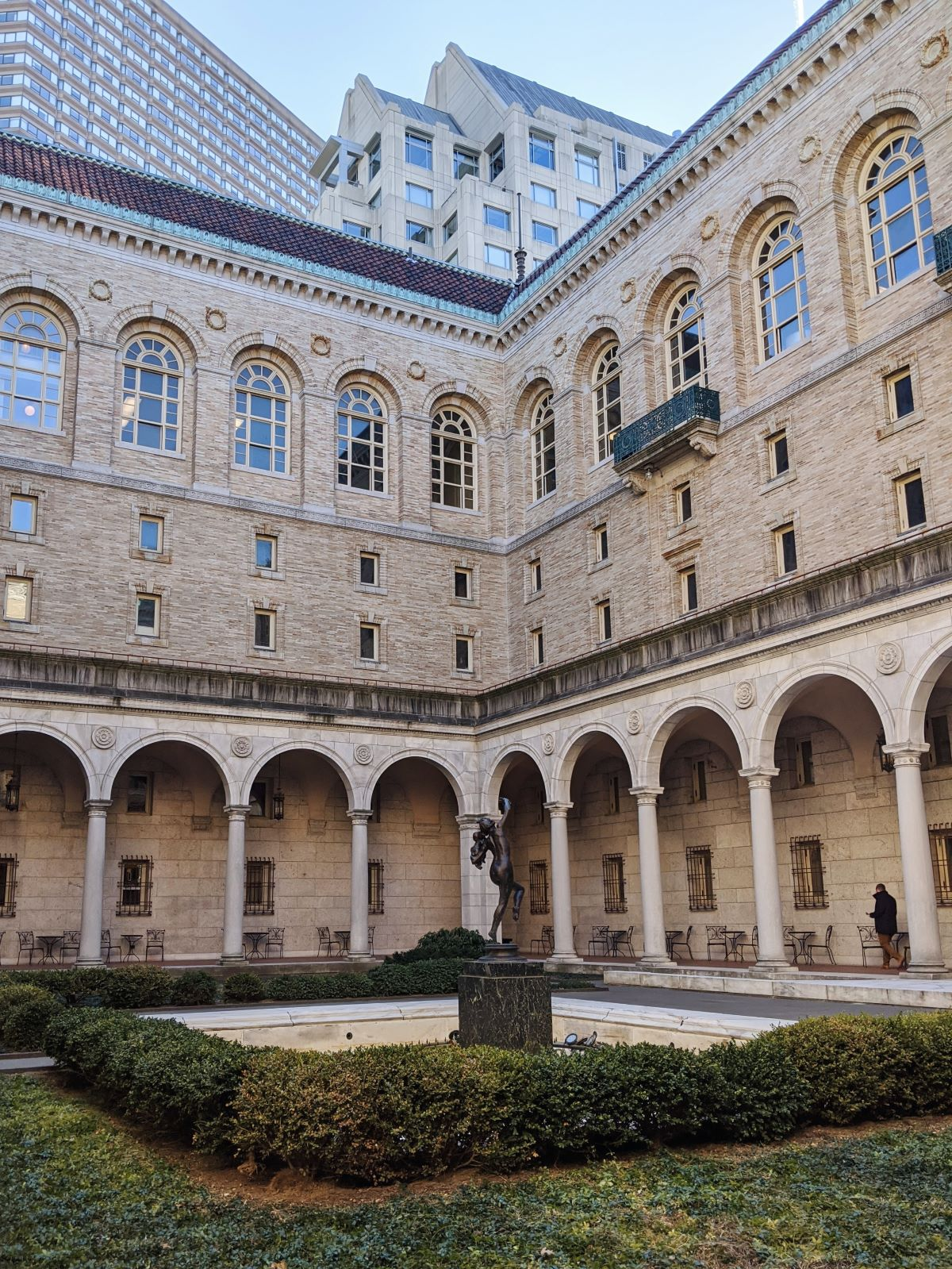 Boston public library courtyard with skyscrapers in the background